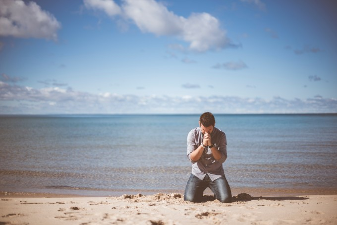 man on his knees on beach-ben-white--unsplash