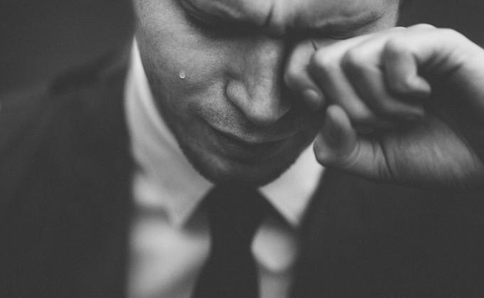 man in suit weeping tom-pumford--unsplash