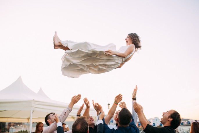 Woman being tossed in the air..vasily-koloda--unsplash