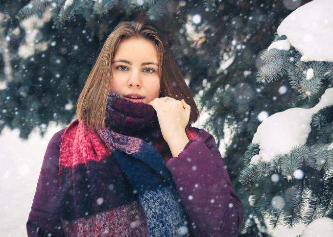 Young woman in snow gazing straight